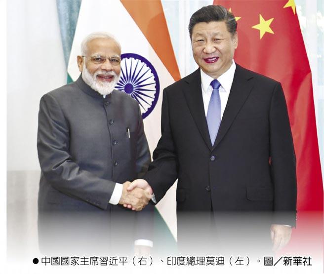 中國國家主席習近平(右)、印度總理莫迪(左)。圖/新華社