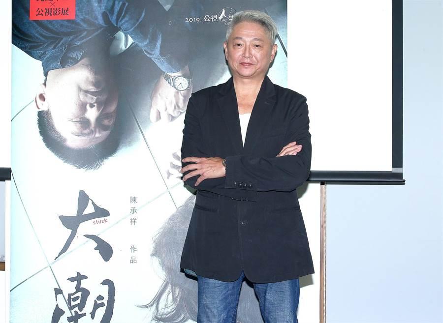 李國超出席《大潮》首映,透露為高欣欣再走入婚姻原因。(粘耿豪攝)