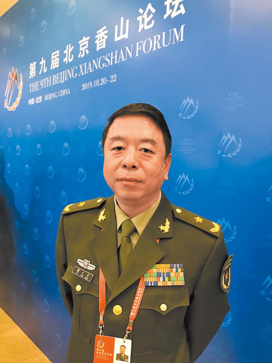 中國軍事科學院科研部副部長徐天昊少將指出,民進黨不搞台獨,兩岸還會有和平。(記者張國威攝)