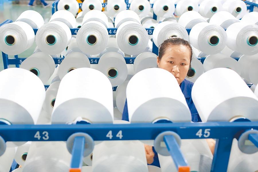 大陸10月財新製造業PMI連續4個月回升。(中新社)