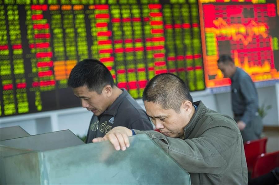 老謝警告:亞洲高收益債恐引爆下個地雷。(中新社)