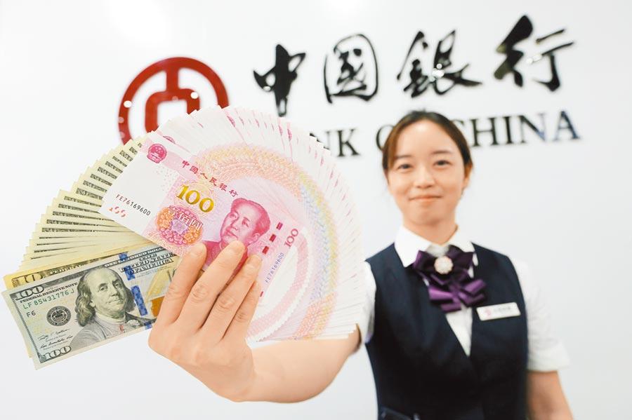 人民幣出現大反彈,專家稱,若美國凍結或取消12月加稅,人民幣甚至有望回到6.8元。(中新社)