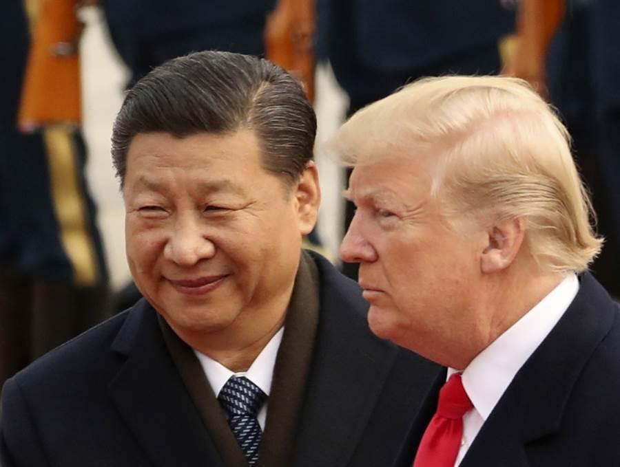 習近平與川普就算會晤簽訂第一階段協議,美中貿易戰還會因雙方各自的政治經濟因素繼績打下去。(圖/美聯社)