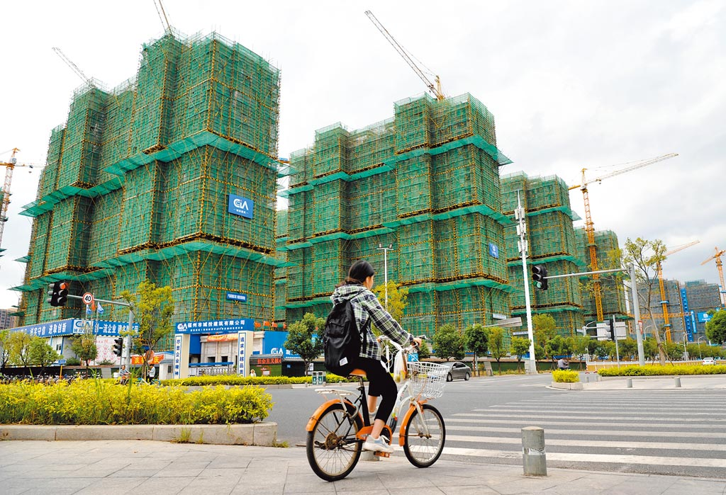 人行不會將房地產作為短期刺激經濟的手段,圖為福州一處正在建設中的工地。(中新社)