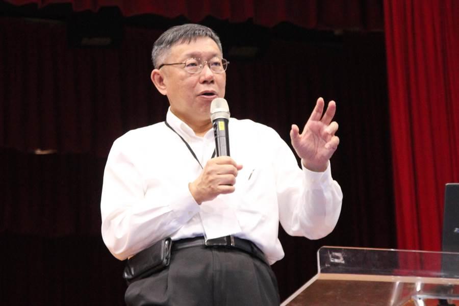 針對韓國瑜工業宅爭議,台北市長柯文哲表示,「秉公處理」,「該怎麼做,就怎麼做」,但與韓無關。(陳淑芬攝)
