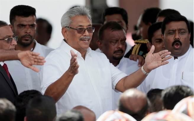 斯里蘭卡新當選總統拉賈帕克薩宣誓就職。(路透)