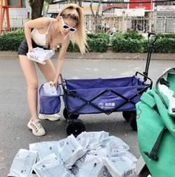 清涼辣妹路邊整理包裹「雪乳溢出」 郵差也瘋狂