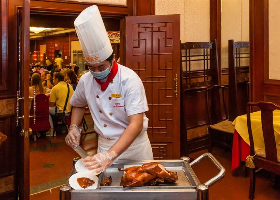 圖為北京烤鴨「全聚德」。(達志)