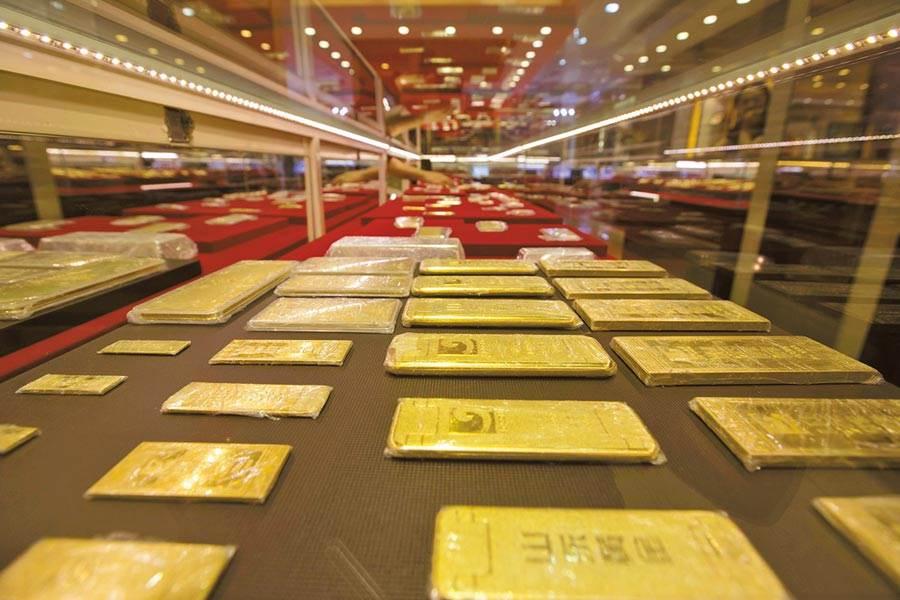 全球黃金ETF持有量也增長了400噸,達到2900噸的歷史新高。(示意圖/中新社)
