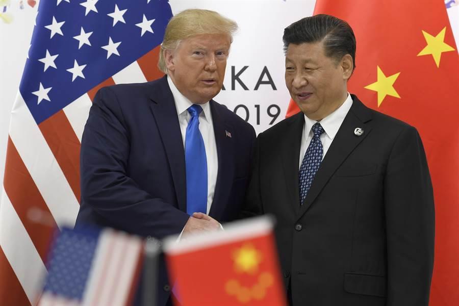 大陸與美國即將簽署貿易協議,協議中將包括承諾購買美國4大項目商品與服務的承諾,但是大部份專家都懷疑這些採購項目是否能全部實現。(圖/美聯社)