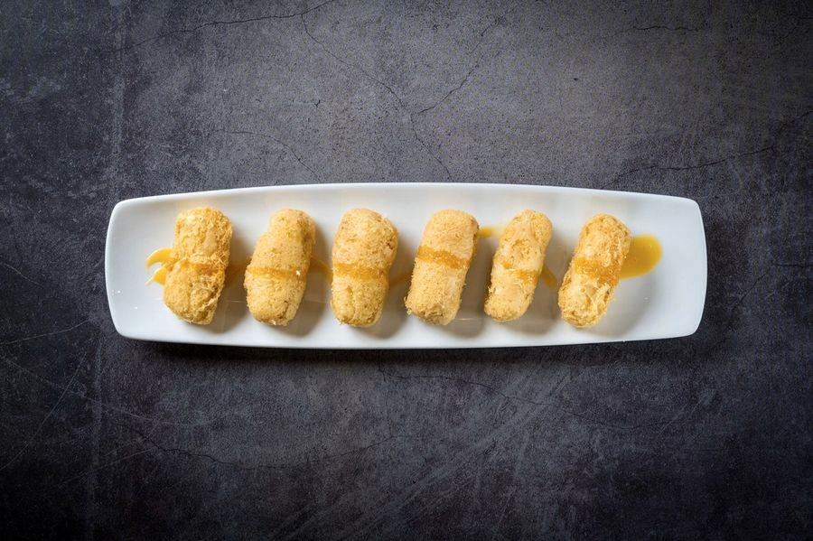 「大良炸鮮奶」外脆內嫩、細膩鮮滑還帶鮮甜,當作甜品也非常合適。(十二粵提供)