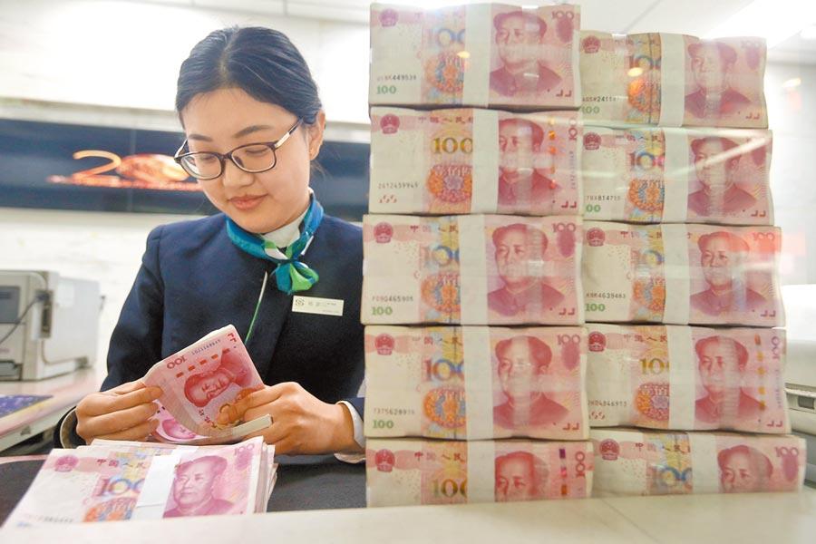 人民幣中間價14日創逾5個月最大升幅。(中新社資料照片)