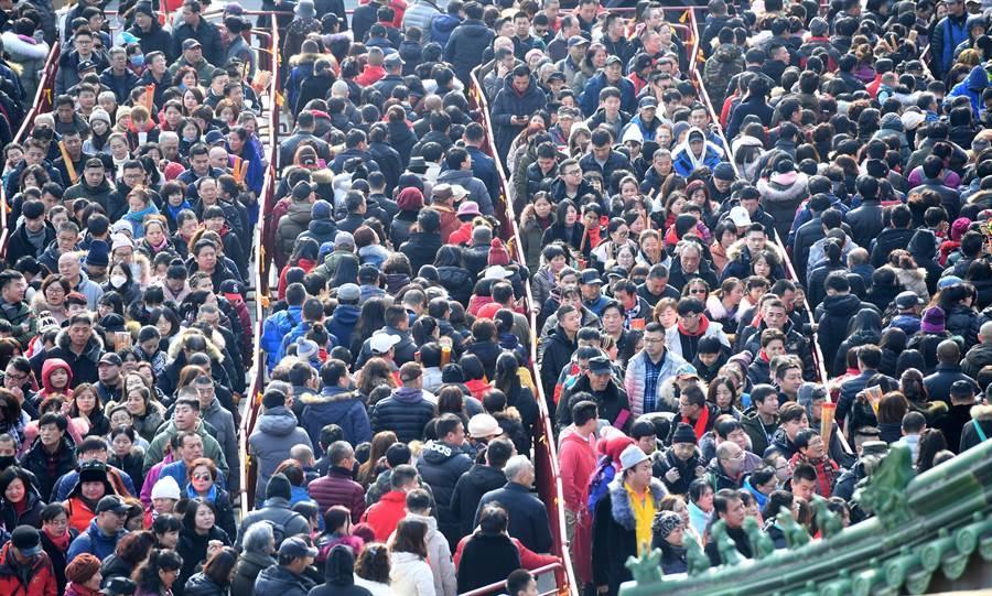 大陸人口突破14億。(圖/新華社)