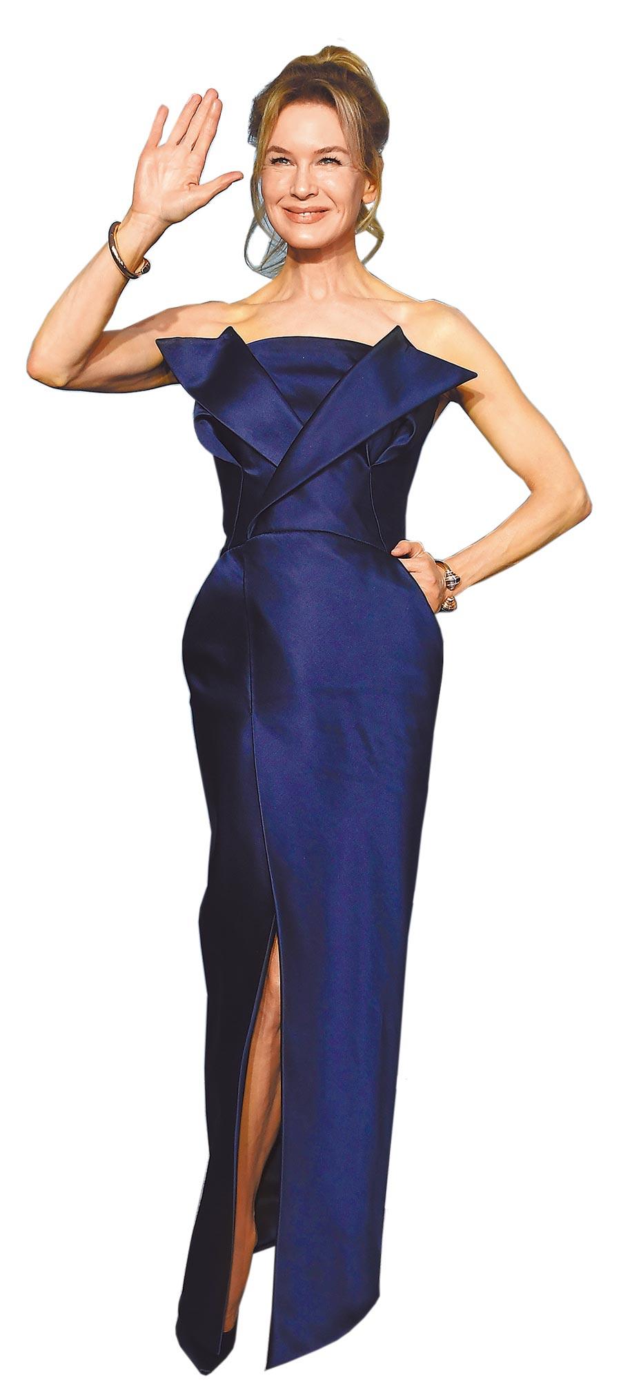 蕾妮齊薇格在演員工會獎上穿Maison Margiela深藍色高訂禮服,展現纖腰好身材。(CFP)