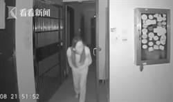 社區30人得新冠肺炎 監視器一看:長髮女「朝門把吐口水」!