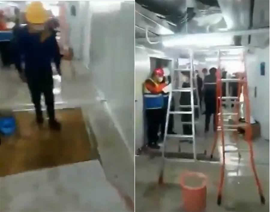 火神山醫院傳漏水,工作人員忙修補。(圖/摘自推特)
