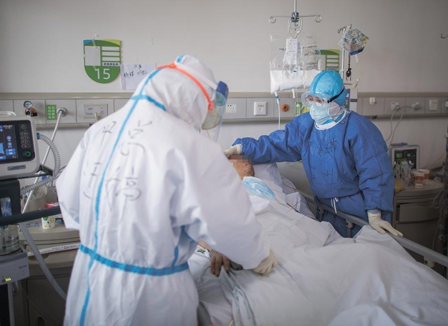 新冠肺炎已進入「全球大流行」局面。圖/新華社