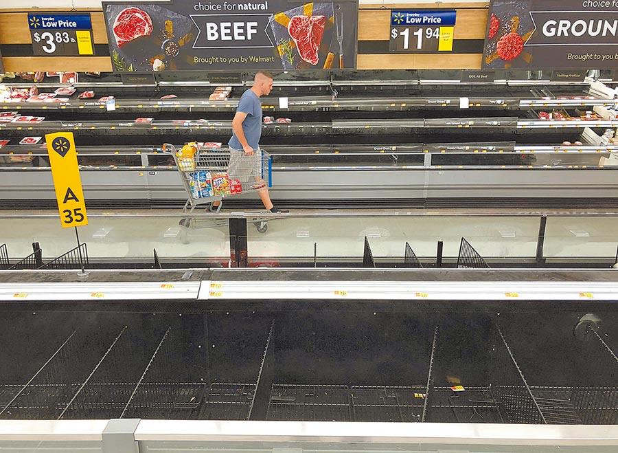 沃爾瑪、亞馬遜等零售商面對大批湧入的需求已令門市與倉庫不堪負荷。圖/美聯社