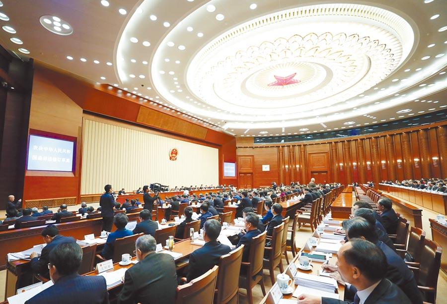 2019年,十三屆全國人大常委會第十五次會議在北京舉行閉幕會。(中新社)