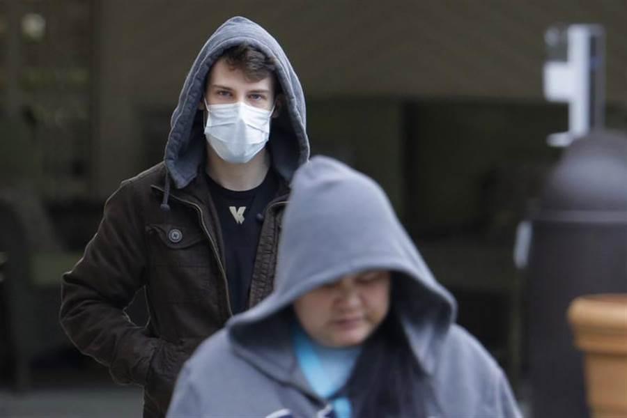 世界衛生組織今天表示,新冠病毒將伴隨世人很長一段時間,多數國家目前仍在抗疫初期階段。(示意圖/美聯社)