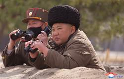 金正恩冷眼看世界 別用常理看北韓