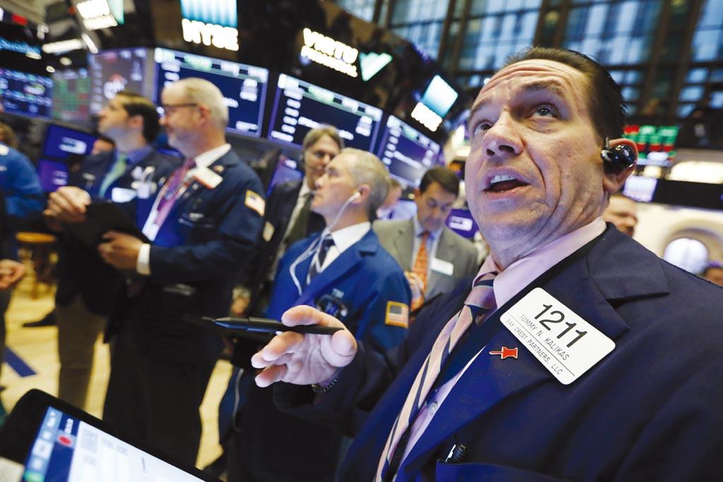 受惠全球央行祭出史上最大寬鬆與企業財報優於預期的拉抬下,美股4月月線長紅。圖/美聯社