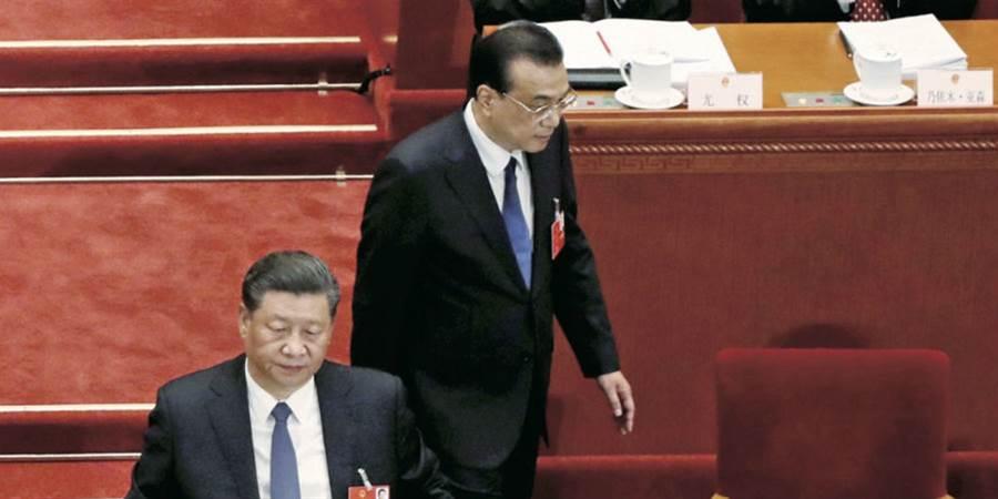 李克強(右)關切中國中低收入者的談話,讓習近平(左)臉上無光。(圖/達志)