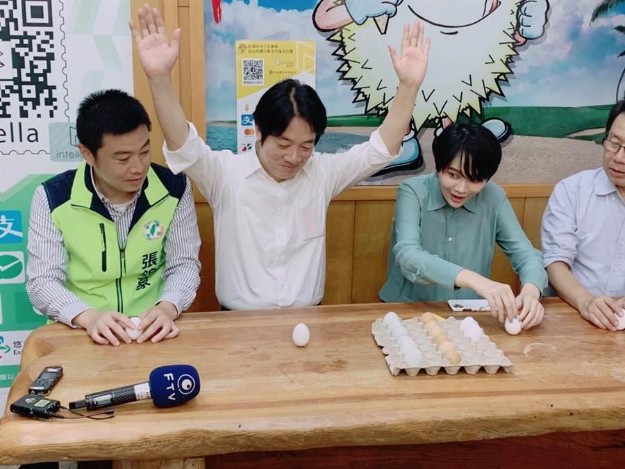 副總統賴清德(中)與新北市立委賴品妤(右)、議員張錦豪(左)比賽立蛋,奪下勝利,現場響起一陣歡呼。(張睿廷攝)