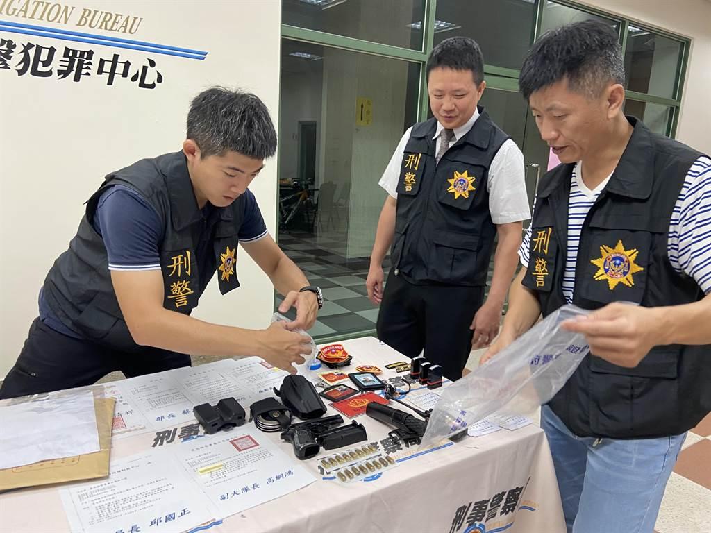 刑事局中部打擊犯罪中心舉行破案記者會,高嫌偽造的證書與法務部與員警的制服擺滿整張桌子。(盧金足攝)