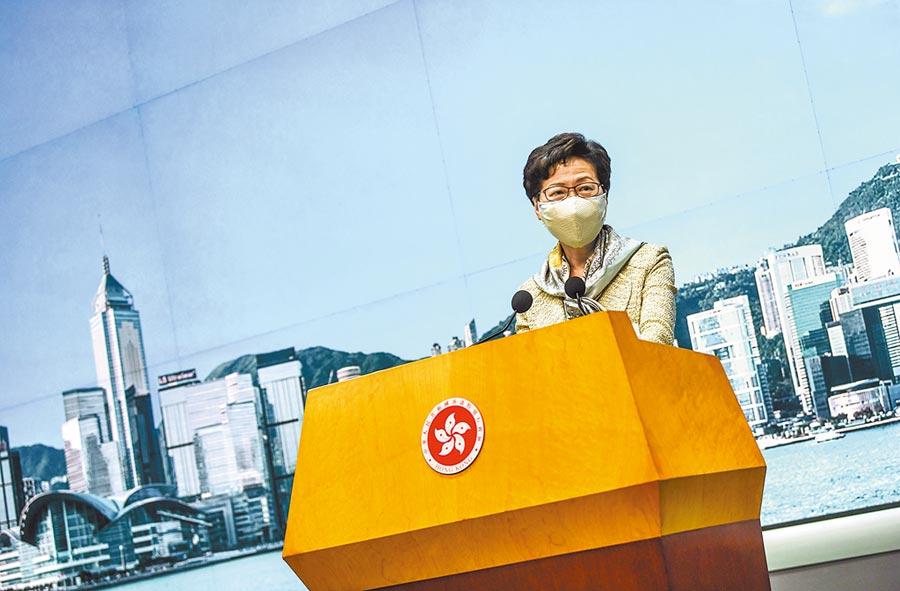 香港特首林鄭月娥表示,任何「制裁」都不會嚇怕特區政府。港版國安法是一國兩制的完善措施。(中新社)