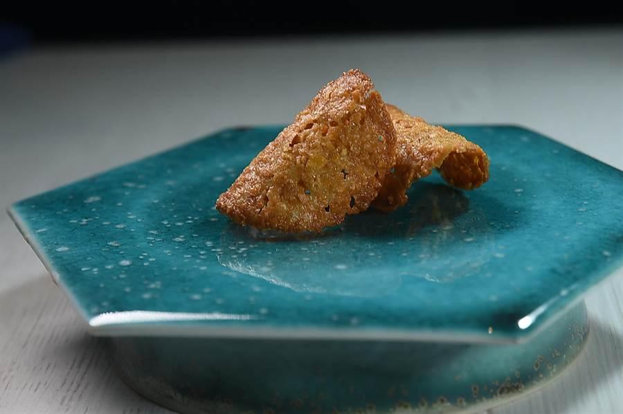 〈柳橙杏仁脆餅〉可搭配飯店咖啡或茶享用。(圖/姚舜)