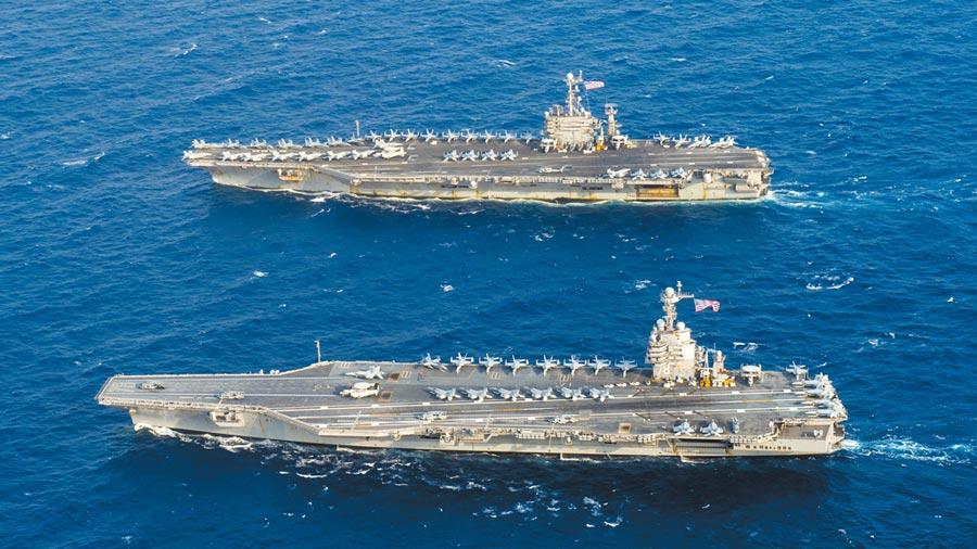 美國航母福特(CVN 78)(前)和尼米茲級航空母艦杜魯門號(CVN 75)(後)6月4日在大西洋航行。 (取自美國海軍官網)