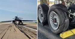 美军B-1B轰炸机件故障急降落 轮子爆胎起火