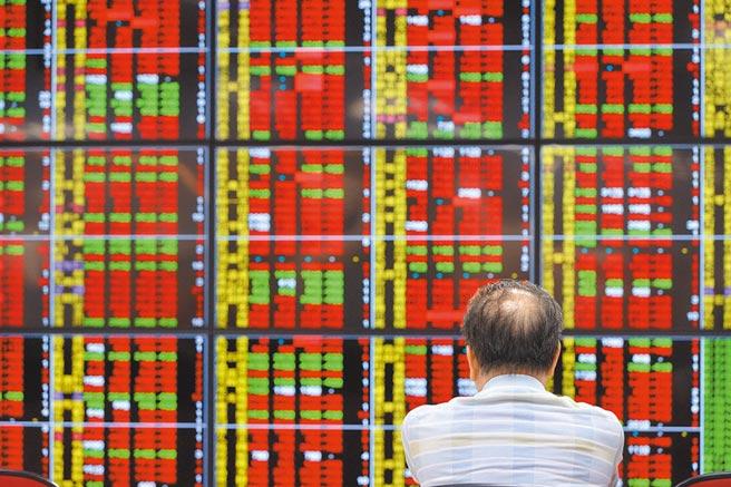 熱錢湧入股市,全球股市上演井噴行情,台灣股市創近30年熱鬧榮景。(本報資料照片)