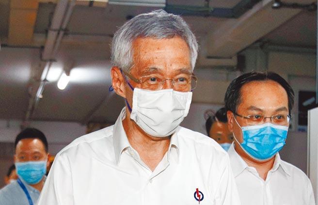 新加坡大選結束,執政的人民行動黨得票率只有61%,跌至接近歷史低位。人民行動黨在在93個議席中,取得83席,成功保住國會大多數。總理李顯龍承認,結果不理想。(路透)