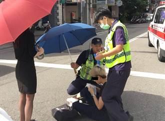 足感心!女子車禍路倒 中市警熱心撐傘遮陽