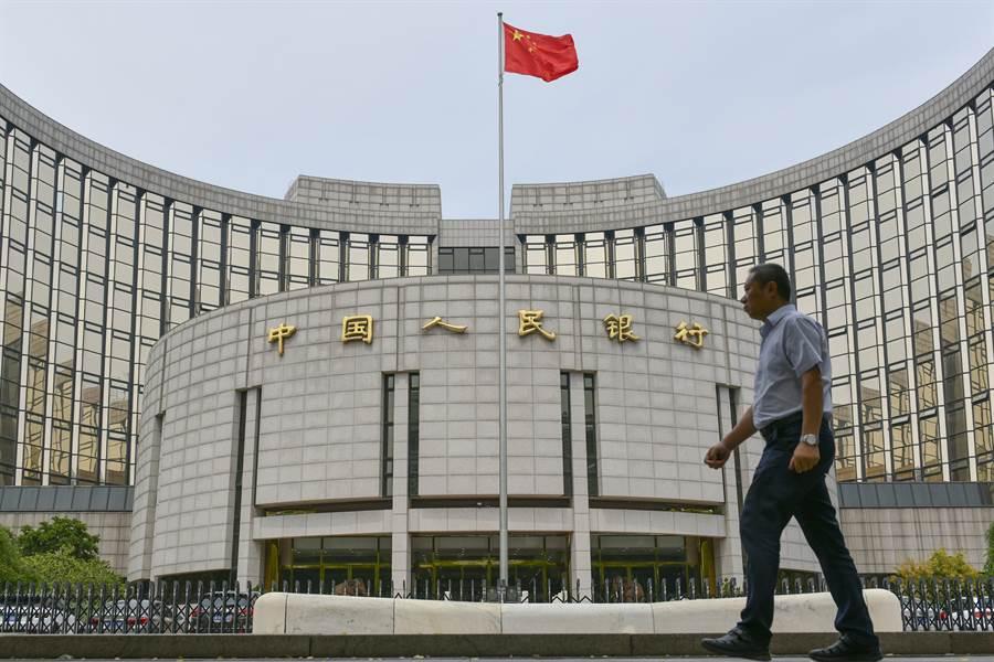 中國人民銀行與網約車巨頭「滴滴出行」等多家互聯網公司展開合作,尋找數位人民幣的應用場景。圖/中新社