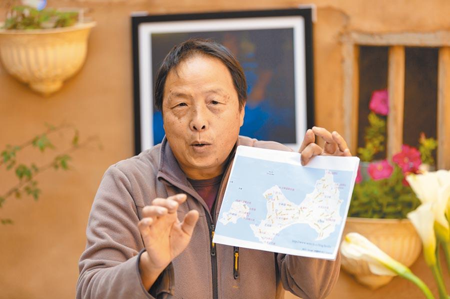 52歲的金門縣攝影學會理事長許進西。(許進西提供/李金生金門傳真)