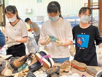 新北志工包裝二手鞋 送暖非洲