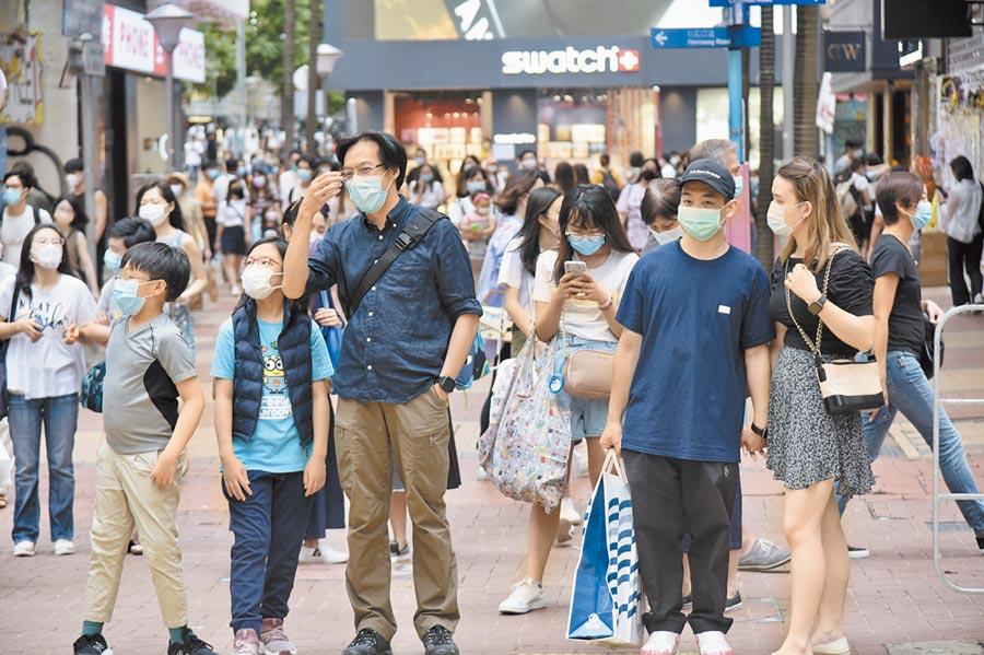 香港特區政府將推出「普及社區檢測計畫」,鼓勵無病徵市民參加。(中新社)
