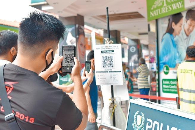 擺脫疫情影響,新加坡政府加速推動電子金融。 圖/美聯社