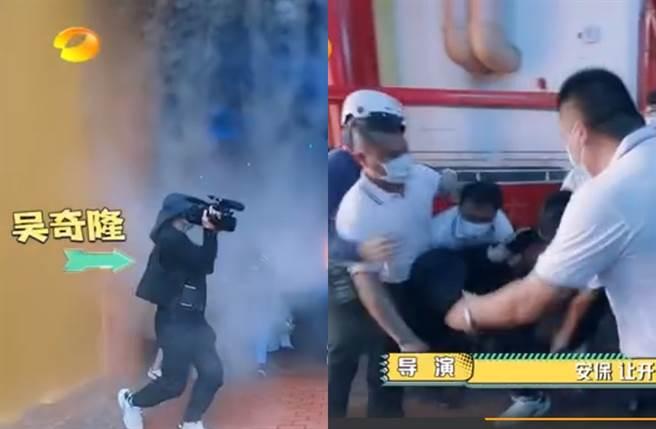 吳奇隆扮成攝影師突襲,反被保安推倒。(圖/翻攝自秒拍)