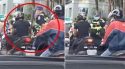 騎士等紅燈猛滑手機 警一旁乖陪看5秒 後方駕駛憋笑到快斷氣