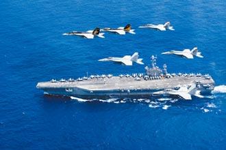 王毅批美 半年3千架次飛南海