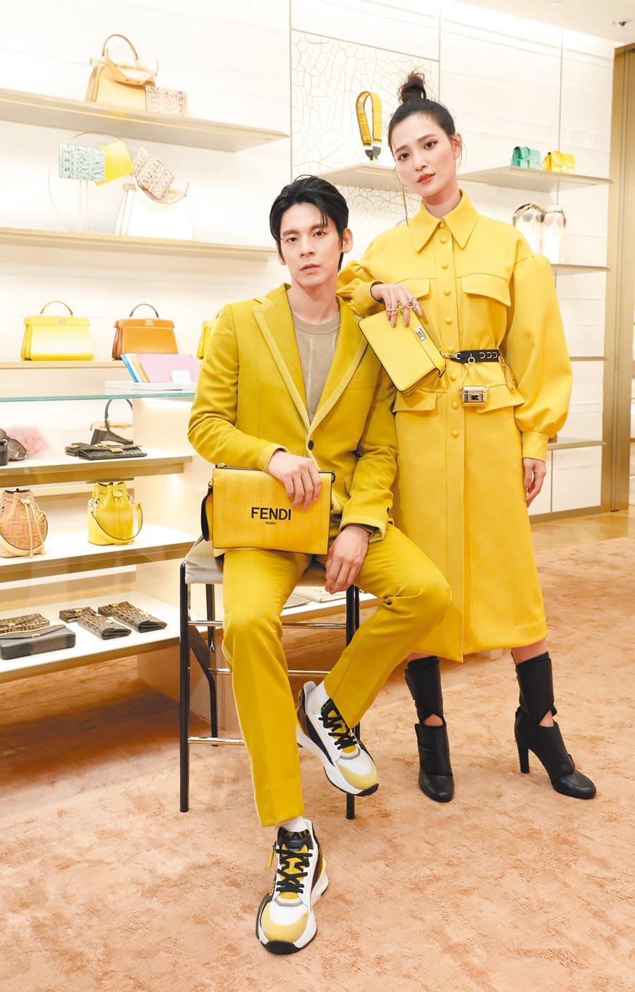 左:林柏宏身穿Fendi針織上衣,2萬1600元;黃色造型西裝,6萬7000元;黃色造型西裝褲,2萬6000元;Flow造型休閒鞋,2萬8700元;Signature造型手拿包,3萬4900元。(Fendi提供)右:吳子霏穿Fendi黃色連身設計洋裝,19萬8000元;Promenade黑色高跟鞋,3萬9000元;Peekaboo ISeeU小型包,8萬3900元;Chaos airpods造型吊飾,2萬4500元;Chaos打火機造型吊飾,1萬9800元;Chaos筆造型耳環,2萬3400元;造型皮帶,2萬8700元。(Fendi提供)