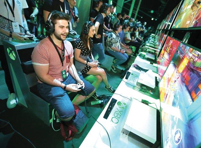 看好全新Xbox和PS系列销售,外资券商美银美林喊买台系游戏供应链。图/美联社