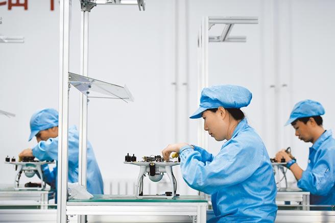 Q3北上資金買進消費電子等科技板塊個股。(新華社資料照片)