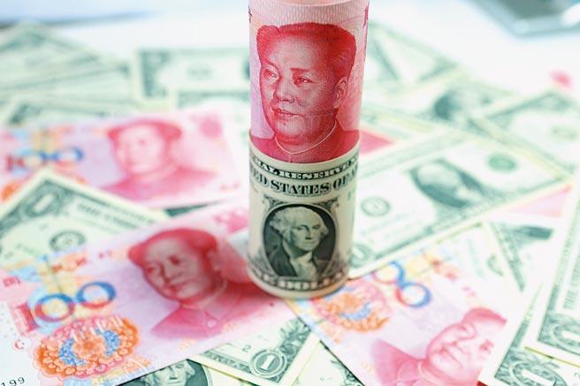 日媒認為人民幣可能會成為新的避險資產。(新華社資料照片)