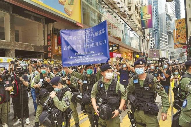涉協助12港人偷渡 港警拘捕9人涉三宗罪。圖為香港銅鑼灣。(美聯社資料照提供)