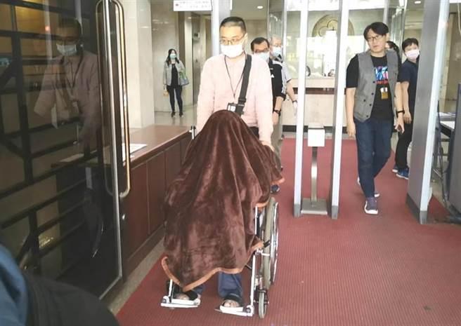 黃琪被遮掩出庭。圖/本報資料照片